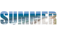 Word SUMMER over pebble beach and blue water of the Mediterranea Royalty Free Stock Photography