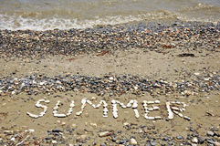 The Word Summer on a Pebbles Beach Royalty Free Stock Photo