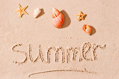 Word summer in sand and seashells Royalty Free Stock Photos