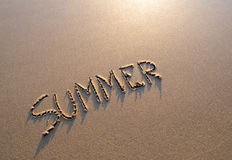 Word summer in the sand Stock Photo