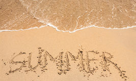 Word summer on the sandy beach Royalty Free Stock Photography