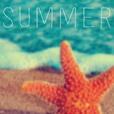 Word summer and a starfish in the seashore Royalty Free Stock Photo