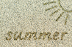 Word Summer and sun drawn on a sand Stock Image
