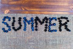 Word summer using juicy berries flat lay royalty free stock images
