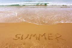 Word summer written on beach sand Royalty Free Stock Image