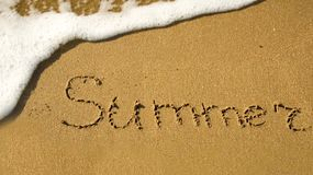 Word Summer written on the sand Stock Photography