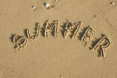 Word summer written by in the sand Royalty Free Stock Photos