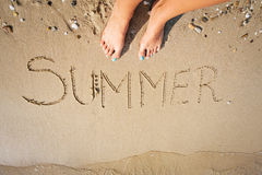 The word summer written in sand Stock Photography