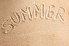 Word summer written by in the sand Royalty Free Stock Images