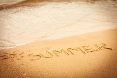The word summer written in the sand on a beach Royalty Free Stock Photo