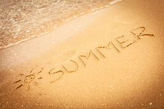The word summer written in the sand on a beach Royalty Free Stock Photography