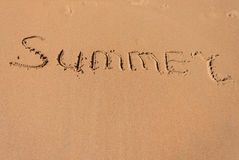 The word summer written in the sand on a beach Stock Photography