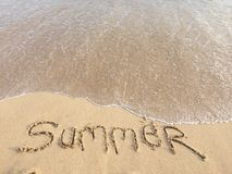 The word Summer written in the sand Royalty Free Stock Photos