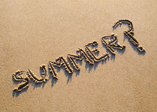 Word summer written in the sand with a question mark Stock Photos