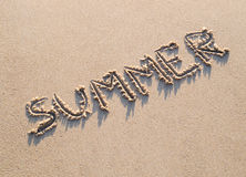 Word summer written in the sand Royalty Free Stock Images