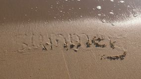 Word Summer written in the sea sand. Waves washed away the inscription. Word Summer written in the sea sand. Waves washed away the inscription stock video