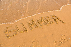Word summer on the yellow sandy beach Stock Image