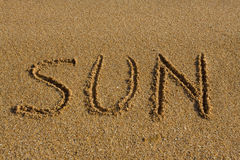 Word sun on the beach. Royalty Free Stock Photo