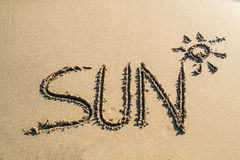 Word sun on beautiful sand. Sun concept word on nice sand beach. Great travel background Stock Image