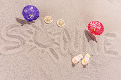 Word sun in german written on the sand of the beach. Word sun Sonne in german written on the sand of the beach Stock Images