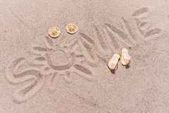 Word sun in german written on the sand of the beach. Word sun Sonne in german written on the sand of the beach Royalty Free Stock Image