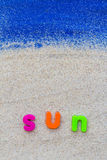 Word sun laid sand blue board Royalty Free Stock Photos