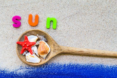 Word sun laid sand blue board Royalty Free Stock Images