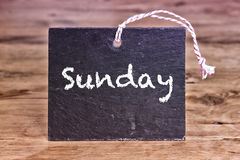 The word Sunday written on chalk board Stock Photography