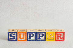 The word supper spelled with alphabet blocks Royalty Free Stock Image