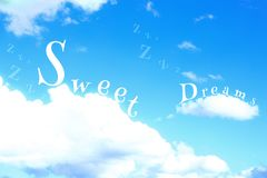 The Word Sweet Dreams In a blue cloudy sky stock photo