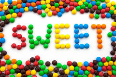 The word sweet, made from colored candies. On white background Royalty Free Stock Image