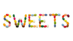 Word SWEETS made of jelly beans on white. Word SWEETS on white background, composed of jelly beans Royalty Free Stock Photos