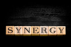 Word Synergy on black background Stock Photography