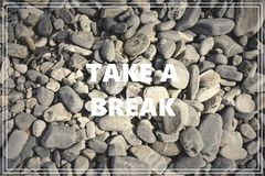 Word Take a Break. Sea stones as background. Stock Image