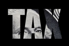 Word TAX cut out of dollar bill royalty free illustration