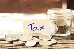 Word tax with money Royalty Free Stock Images