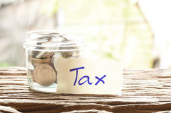 Word tax with money Stock Image