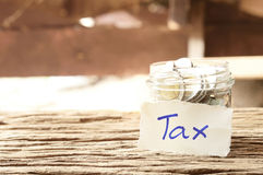 Word tax with money Royalty Free Stock Photo