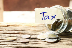 Word tax with money Royalty Free Stock Image