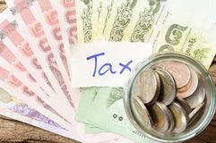 Word tax with money Royalty Free Stock Photography