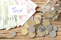 Word tax with money Stock Photography