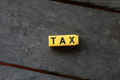 Word tax on a wooden table Stock Photo