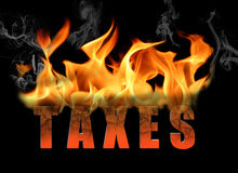 Word Taxes in Fire Text Stock Images