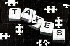 The Word Taxes - A Term Used For Business, Finance and Government Concept Royalty Free Stock Photography