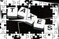 The word taxes - a term used for business, finance and government concept. The word taxes spelled out with white tiles on black background Stock Photography