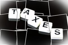 The Word Taxes - A Term Used For Business, Finance and Government Concept Stock Photography