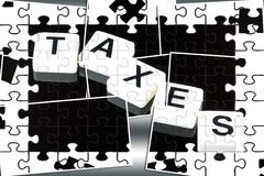 The Word Taxes - A Term Used For Business, Finance and Government Concept Stock Photo