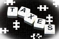 The Word Taxes - A Term Used For Business, Finance and Government Concept Royalty Free Stock Photo