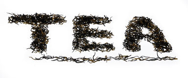 The Word Tea. Written using black oolong tea from china on isolated background Stock Image