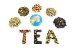 Word TEA with globe and various heaps of tea species Royalty Free Stock Photography